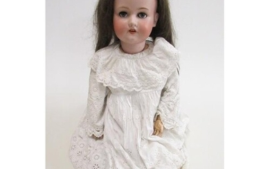 An Armand Marseille bisque socket doll with blue glass sleep...