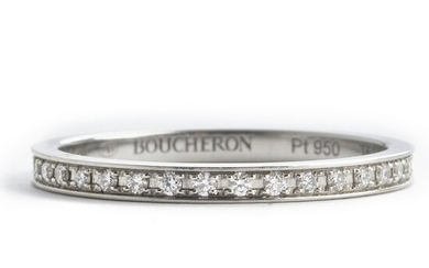 Boucheron: A diamond eternity ring set with numerous brilliant-cut diamonds, mounted in platinum. D-G/IF-VS. Size 53. Ref. no. JAL00230–53. Serial no. N94909.