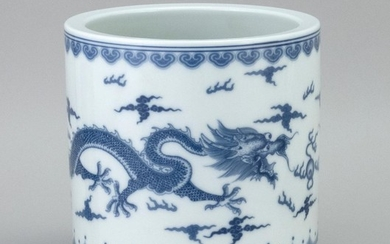 """CHINESE BLUE AND WHITE PORCELAIN BRUSH POT With a five-clawed dragon design. Six-character Kangxi mark on base. Height 7"""". Diameter 7""""."""