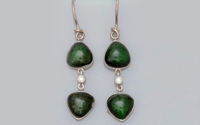 Earrings in white gold, 750 MM, each adorned with two tallow green tourmalines set with a diamond, length 3 cm, weight: 4.2gr. rough.