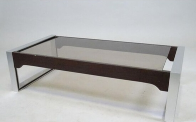GUILLARD Claude. Coffee table in rosewood and chromed metal. Glass...