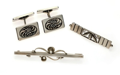 NOT SOLD. Georg Jensen: A pair of cufflinks and two brooches of sterling silver. L....