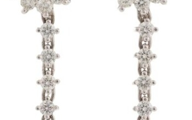 Long earrings white gold 18kts First body brilliant rosette, center brilliant cut diamonds and lower body marquise cut central sapphire with diamonds Estimated weight sapphire 1.80 cts, estimated weight brilliant 4.1 cts Total weight 11.5 g
