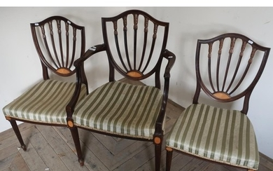 Mahogany inlaid shield shape backed armchair with carved det...