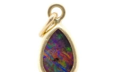 Opal doublet and yellow gold pendant / charm unmarked. Appro...