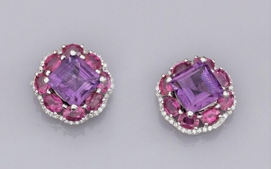 Pair of 18K white gold earrings set with square amethysts (about 3 cts each), surrounded by oval pink rubies and brilliant-cut diamonds. 9.4 g. Width: 1.5 cm. Eagle's head hallmark