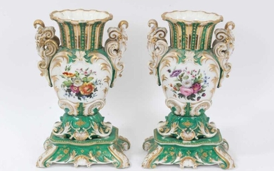 Pair of 19th century French porcelain vases, of baluster form with scrollwork handles and base, painted with floral sprays on a green gilt ground, 26cm height