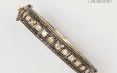 Rigid bracelet opening in silver, adorned with rose-cut diamonds set with lines of smaller diamonds on the edge of the bracelet. P. Rough: 46.1 g.