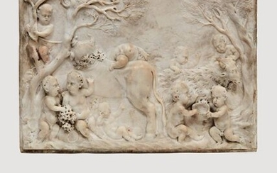 Sculpted marble PLATE in high relief representing a bacchanal of nine children in a wooded landscape playing with a goat and a bovid, a second goat visible behind a tree at the left end. In the foreground, two children fighting over a bunch of grapes...