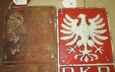 Two Polish railway cast iron plaques, each with relief mould...