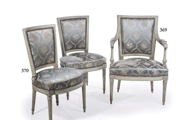 Two chairs (the same model as the armchair) with curved trapezoidal backrest, in grey lacquered wood with mouldings and grooves. It rests on four tapered fluted legs.