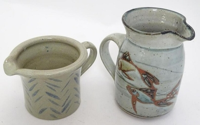 Two studio pottery jugs, one with stylised fish