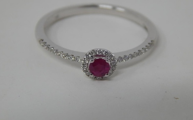 18ct white gold ruby and diamond ring, central round cut rub...