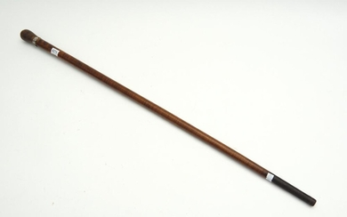 A 19TH CENTURY AUSTRALIAN FIDDLEBACK BLACKWOOD WALKING STICK WITH FLORAL SILVER BAND