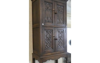 A Carved Oak Side Cabinet with Panelled Doors, Stretcher She...