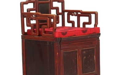 A Chinese hardwood armchair with compartment underneath the seat. First half of the 20th century. Modern cushion.