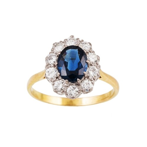A DIAMOND AND SAPPHIRE CLUSTER RING, the oval sapphire to a ...