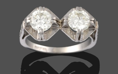 A Diamond Two Stone Ring, the round brilliant cut diamonds...