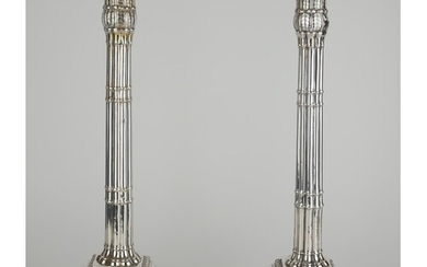 A PAIR OF GEORGIAN SILVER CANDLESTICKS Classical form with b...