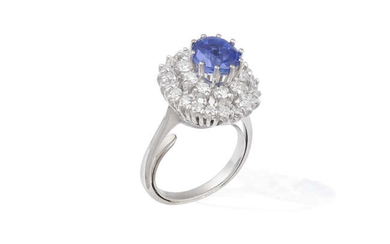 A SAPPHIRE AND DIAMOND CLUSTER RING The cushion-shaped...