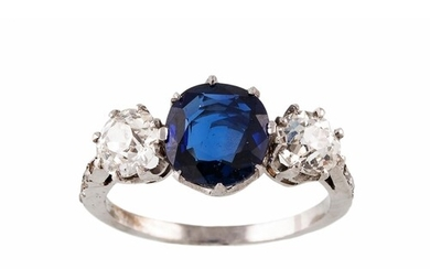 A SAPPHIRE AND DIAMOND THREE STONE RING, the oval sapphire f...