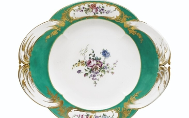 A SEVRES PORCELAIN GREEN-GROUND STAND (PLATEAU 'A QUATRE PANS RONDS'), CIRCA 1758, BLUE INTERLACED L'S ENCLOSING DATE LETTER E, UNIDENTIFIED PAINTER'S MARK, INCISED 7