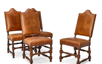 A Set of Four Baroque Style Leather Upholstered Oak Chairs