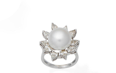 A cultured pearl and diamond pearl ring