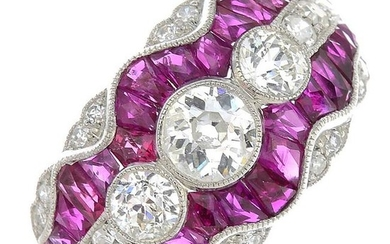 A diamond and ruby dress ring.Estimated total diamond
