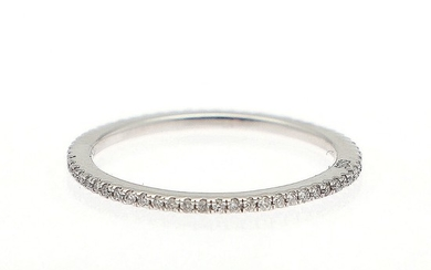 A full diamond eternity ring set with numerous brilliant-cut diamonds, mounted in 14k white gold. W. 1.2 mm. Size 55.5.