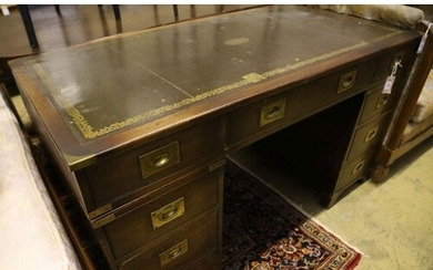 A military style mahogany and brass bound twin pedestal desk...
