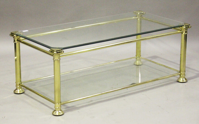 A modern gilt brass and glass rectangular coffee table with Ionic column supports, height 46cm, leng