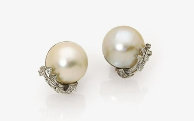 A pair of ear clips with Mabé - cultured pearls and