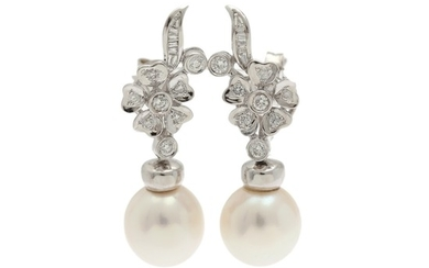 A pair of pearl and diamand ear pendants set with a cultured fresh water pearl and numerous baguette and brilliant-cut diamonds, mounted in 18k white gold. (2)