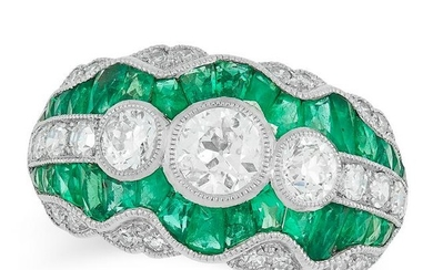 AN EMERALD AND DIAMOND DRESS RING set with three