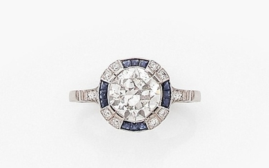 ANNEES 1930 BAGUE ENTOURAGE DIAMANT A 1,90 carat approx. diamond, sapphire and platinum ring, circa 1930.