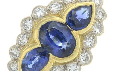 An 18ct gold sapphire three-stone ring, with diamond