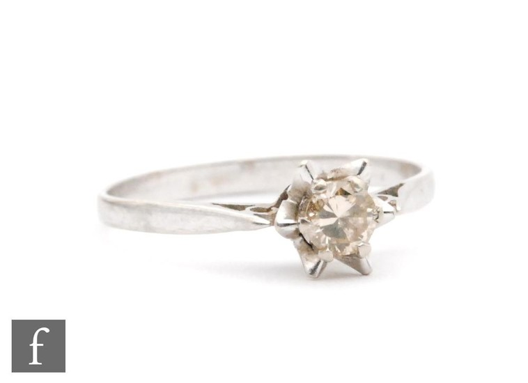 An 18ct white gold diamond solitaire ring, claw set brillian...