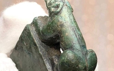 Ancient Roman Bronze Curious Figurine of a lying Panther but seen from above a Phalus. An Interesting Game of Images.