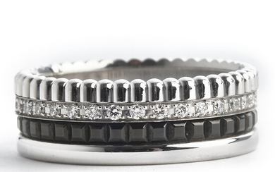"""Boucheron: A diamond ring """"Quatre Black Edition"""" set with numerous brilliant-cut diamonds weighing a total of app. 0. 26 ct., mounted in 18k white gold. D-G/IF."""