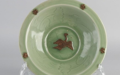 Deep Chinese celadon porcelain dish with bird / rosette