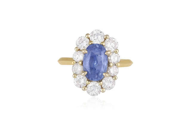 Description A SAPPHIRE AND DIAMOND CLUSTER RING The elongated...