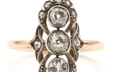 Diamond ring set with three old mine- and numerous rose-cut diamonds, mounted in 14k gold and silver. Size 54. C. 1900–1910.
