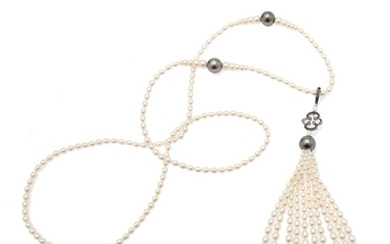 Hartmann's: A hinged pearl and diamond pendant set with numerous pearls and black diamonds and a necklace set with numerous pearls. L. 80 cm.