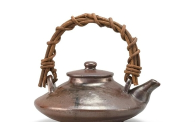 """JAPANESE NAESHIROGAWA POTTERY TEAPOT In squat ovoid form, with black-brown glaze. Length 5.75""""."""
