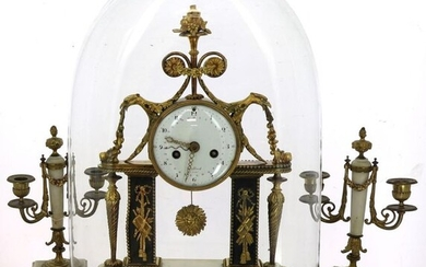 """Louis XVI style mantel set in white alabaster, black marble and gilded bronze comprising a glass globe clock (H 45 cm) and blackened wood base (H 55 cm) and a pair of two-armed candelabra, H 29.5 cm. Enamelled dial signed """"Collard à Paris"""". Thread..."""