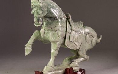 MODERN CHINESE GREEN HARDSTONE MODEL OF A HORSE, on wooden s...
