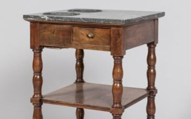 Mahogany and mahogany veneer refreshment table opening with 1 drawer in belt, 2 shelves. Baluster base on castors. Marble top with 2 zinc coolers. Restoration period. Small accidents mainly in the back. Dim: 74x44cm