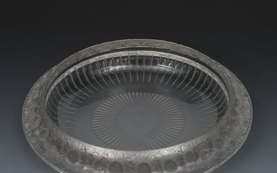 Marguerites' No.10-404 a Lalique clear and frosted glass bowl designed by Rene Lalique, cast with a frieze of flowerheads to the rim, and a modern Lalique Festons four piece chemin de table, stencil Lalique France mark, 35cm. diam. (5)