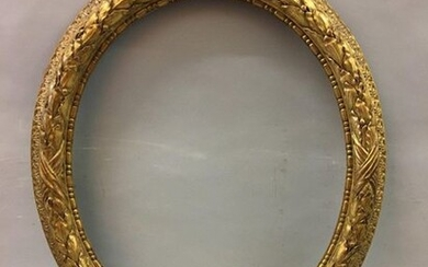 *Oval carved and gilded wood frame